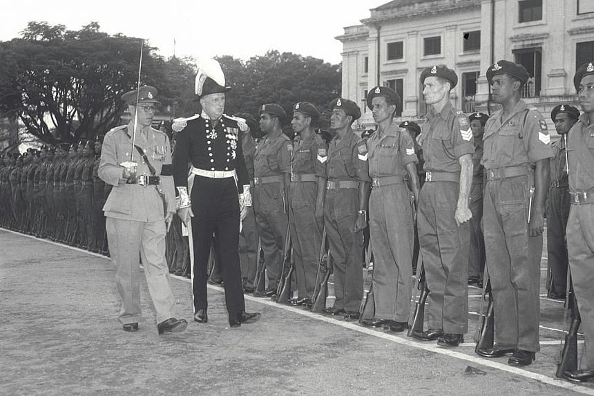 Then Governor of Singapore, Sir Franklin Gimson, inspecting the guard of honour provided by the Singapore Volunteer Corps. The contributions of the militia group will be celebrated this year as the country and Singapore Armed Forces (SAF) turn 50, De