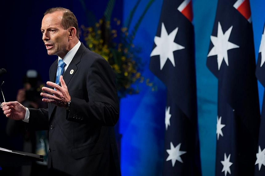 """Australian Prime Minister Tony Abbott says his government have """"lessons to learn"""" from a stunning state election rout in Queensland, amid growing questions about his leadership after his unpopular move to knight Britain's Prince Philip. -- PHOTO: BLO"""