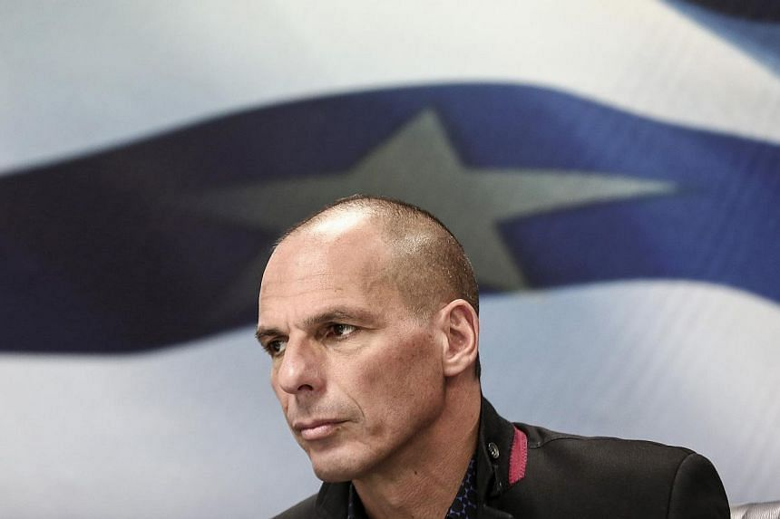Yanis Varoufakis, Greece's incoming finance minister, pauses during the handover ceremony in Athens, Greece, on Wednesday, Jan 28, 2015. -- PHOTO: BLOOMBERG