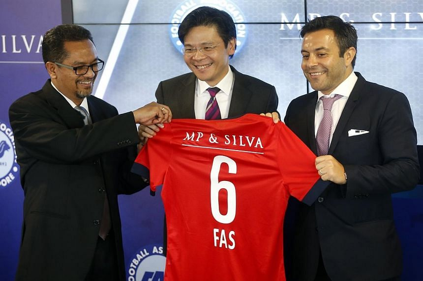(From left) FAS president Zainudin Nordin and Minister for Culture, Community and Youth Lawrence Wong present a jersey to MP & Silva founding partner Andrea Radrizzani. -- ST PHOTO: KEVIN LIM