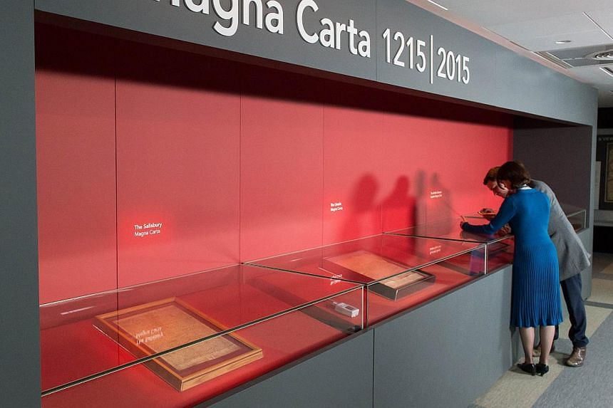 The four surviving original Magna Carta copies are pictured in display cases at the British Library in central London on Feb 2, 2015. The four copies went on display together for the first time as Britain marks the 800th anniversary of a manuscript w
