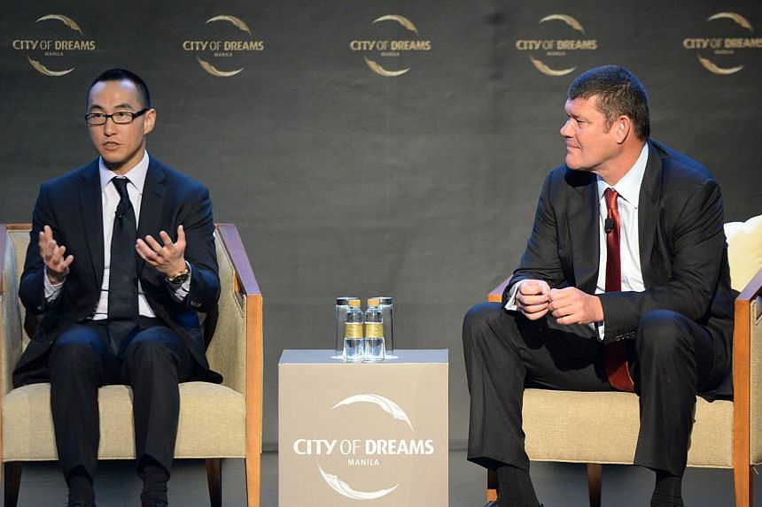 Lawrence Ho (left), son of Macau gaming tycoon Stanley Ho, and co-chairman of Melco crown speaks as his co chairman, Australian billionaire James Packer listens during a press conference at the newly-opened City of Dreams mega-casino in Manila on Feb