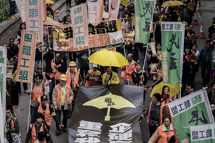"""Demonstrators march for democracy in Hong Kong on Feb 1, 2015. A disappointing turnout at Hong Kong's first democracy rally since the end of mass street demonstrations shows the city is suffering from """"protest fatigue"""" and new longer-term strategies"""