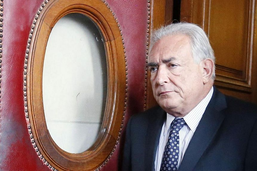 Former IMF chief Dominique Strauss-Kahn leaving the Paris courthouse after attending a hearing onFeb 26, 2013. MrStrauss-Kahn, who had been tipped to become French president before a New York hotel maid accused him of sexual assault in 20