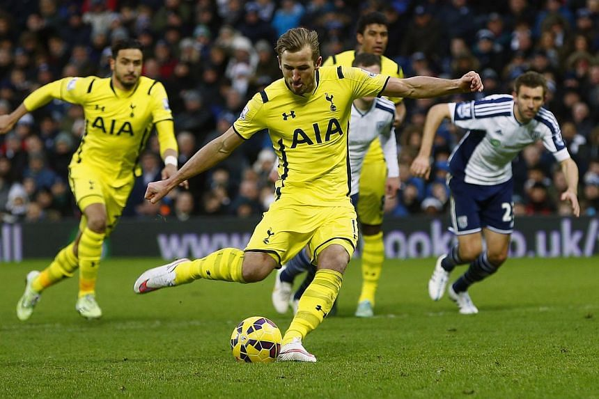 Tottenham Hotspur's Harry Kane (centre) prepares to shoot from the penalty spot against West Bromwich Albion during their English Premier League football match in West Bromwich, central England on Jan 31, 2015. Kane has signed a new fi