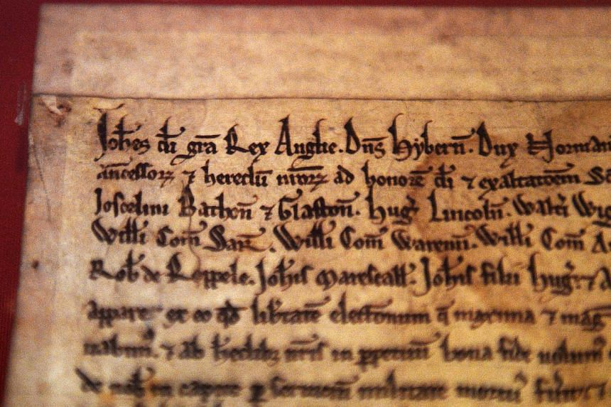 A close-up view of the Salisbury Magna Carta, at the British Library in London, Britain onFeb 2,2015. -- PHOTO: EPA