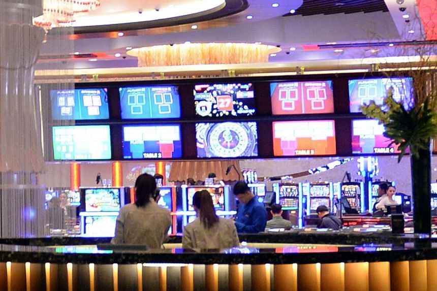 Restaurant employees work next to the casino of the newly-opened City of Dreams mega-casino chain in Manila on Feb 2, 2015. A new mega-casino opened in the Philippines on Monday as the fast-growing southeast Asian nation ups its bid to become a world