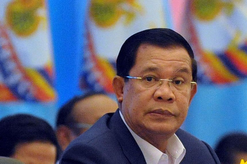 Cambodia's Prime Minister Hun Sen attends the start of the two-and-a-half-day ruling Cambodian People's Party (CCP) congress in Phnom Penh on Jan 30, 2015.Cambodia's ruling party named three sons of Mr Hun Sen to its upper ranks on Sunday, Feb