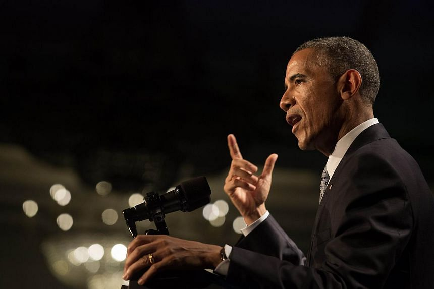 USPresident Barack Obama has put forward a US$4 trillion (S$5 trillion) budget loaded with spending and tax reforms that will likely be dead on arrival at the Republican-controlled Congress. -- PHOTO: AFP