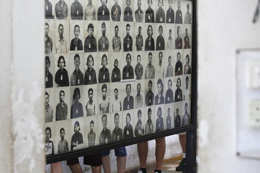 Photographs of Khmer Rouge victims are seenat the Tuol Sleng Genocide Museum, also known as the notorious security prison S-21, in Phnom Penh onJan 21, 2015. Cambodia's UN-backed court on Monday, Feb 2, heard a former prisoner say he help