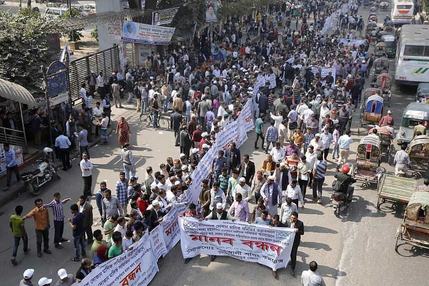 Shop owners and business association representatives form a chain to protest against the blockades during a countrywide strike called by the Bangladesh Nationalist Party (BNP) in Dhaka on Feb 2, 2015. The owner of a leading Bangladeshi televisio
