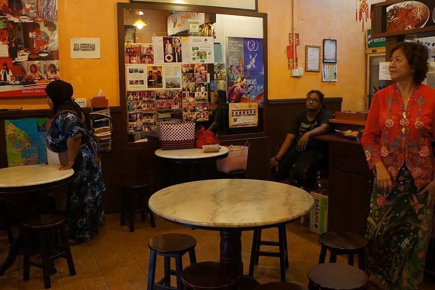 Part of the Teo family's ancestral home in Kampung Cina has been turned into a small restaurant run by Madam Tan Choo Bee (right). -- PHOTO: CAROLYN HONG