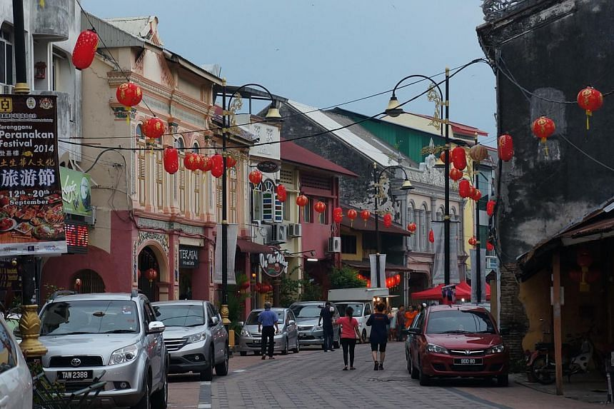 Kampung Cina, a row of old shophouses built over the centuries in various styles from art deco to southern Chinese, located in the state capital of Kuala Terengganu. The picturesque street was once mainly settled by the Chinese, but now has a more mi