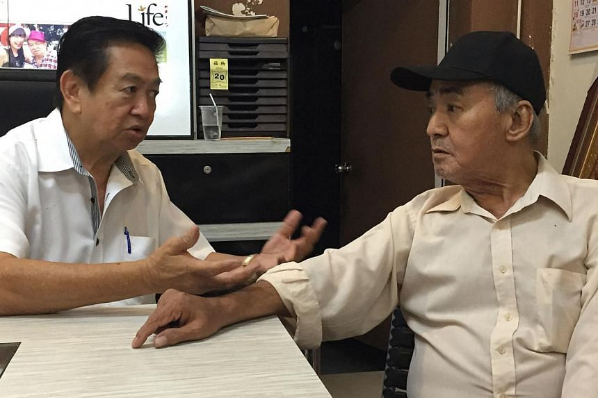 Undertaker Roland Tay (left) speaking to Mr Ong Teck Eng, the father of Mr Ken Ong, who allegedly murdered his wife before turning the same knife on himself. Mr Tay paid for the rites and cremation. (Right) The older Mr Ong at his son's cremation in