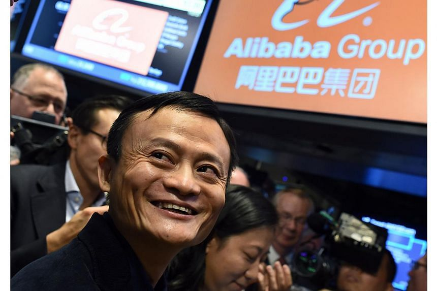 Alibaba Group Holding chairman Jack Ma regained his spot as Asia's richest person with a higher valuation for the company's finance affiliate ahead of a stock sale that also created a dozen new billionaires. -- PHOTO: AFP