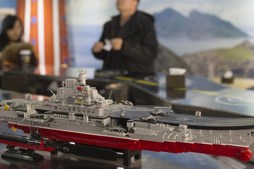 A model of China's first aircraft carrier, the Liaoning. A company has won a contract to supply cabling for a second Chinese aircraft carrier, comments by the local authorities suggested, in the latest sign that Beijing is boosting its maritime power
