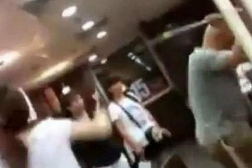 A woman being attacked in front of onlookers at a McDonald's outlet in China's eastern province of Shandong. She was attacked to death by six people who are members of the Church of Almighty God (Quannengshen) religious movement, for refusing to give