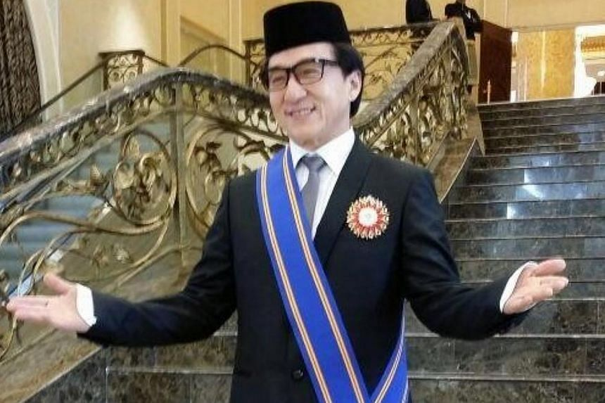 Hong Kong superstar Jackie Chan surprised many when he turned up to receive his Datukship from the King of Malaysia on Sunday, in conjunction with Federal Territory Day. -- PHOTO: TWITTER / KHAIRY JAMALUDDIN