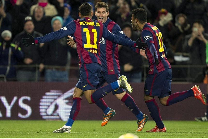 FC Barcelona's Lionel Messi (centre) celebrates with Neymar (left) and Rafinha (right) after scoring the 3-2 leading against Villarreal during the Spanish Primera Division soccer match between FC Barcelona and Villarreal CF at Camp Nou in Barcelona,