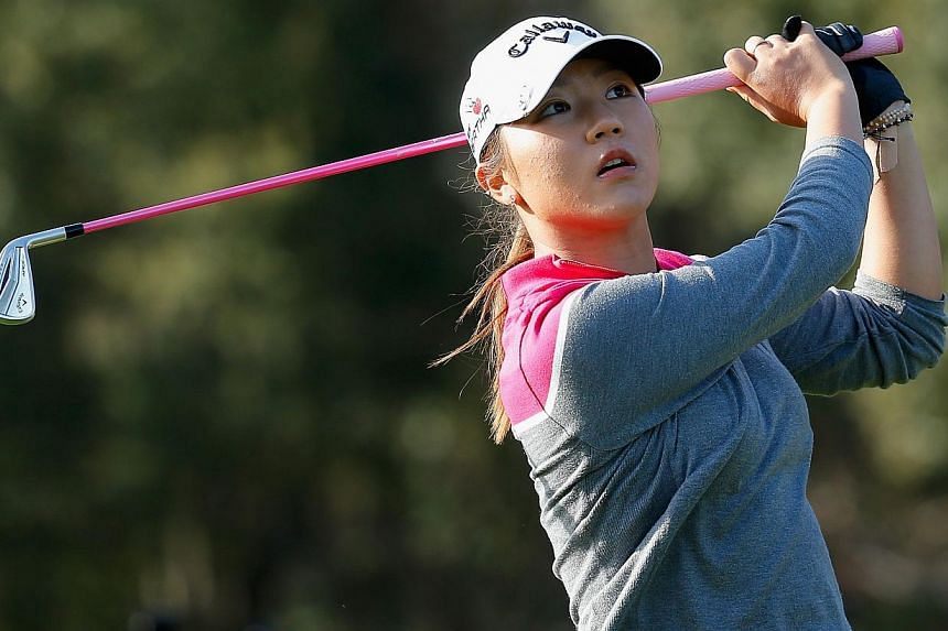 Lydia Ko of New Zealand watches her tee shot on the 15th hole at the Coates Golf Championship Presented by R+L Carriers - Final Round at the Golden Ocala Golf & Equestrian Club on Jan 31, 2015 in Ocala, Florida. -- PHOTO: AFP