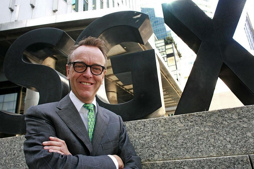 CEO of SGX Magnus Bocker poses in front of the Singapore Exchange offices in Singapore on Jan 28, 2015. SGX will hire more people in China as it seeks to sell more of its products in Asia's largest equities market. -- PHOTO: REUTERS