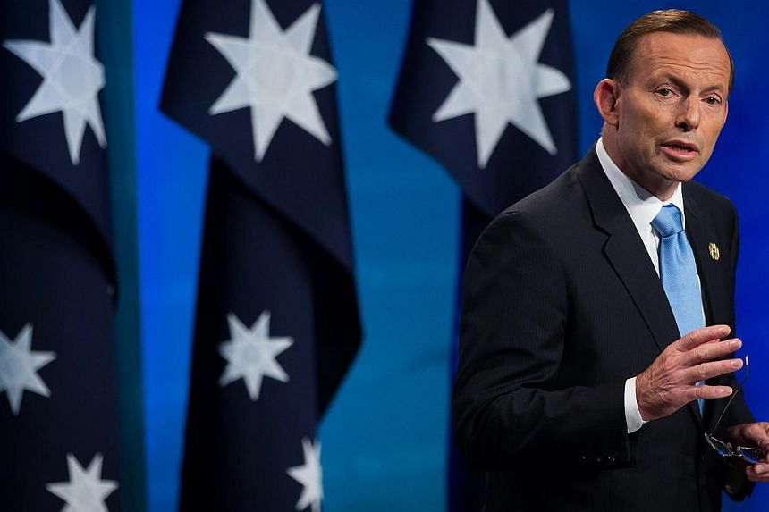Australia's conservative Prime Minister Tony Abbott, in a key speech to the National Press Club in Canberra on Monday, said his government will focus on jobs and families in new policies. -- PHOTO: BLOOMBERG