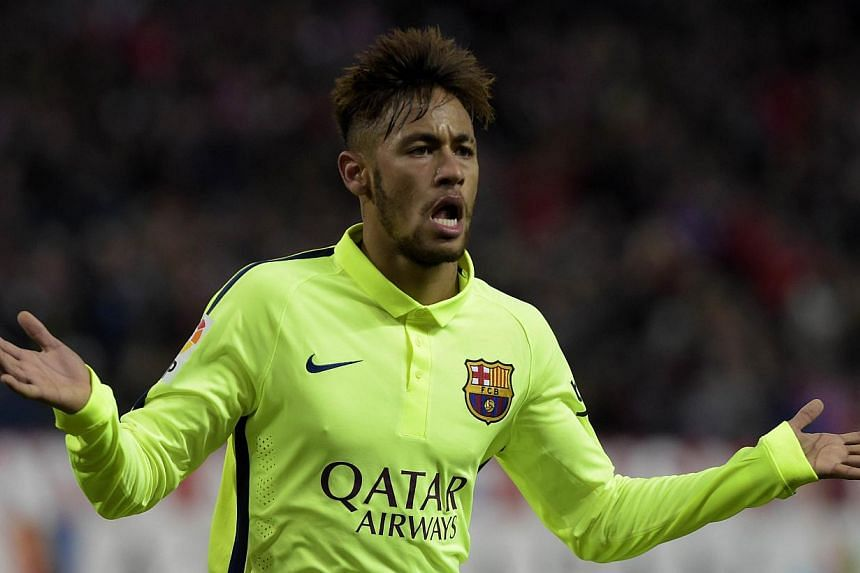 Barcelona's Brazilian forward Neymar celebrates after scoring his second goal during the Spanish Copa del Rey quarter-final second leg against Atletico Madrid at the Vicente Calderon stadium in Madrid on Jan 28, 2015. -- PHOTO: AFP