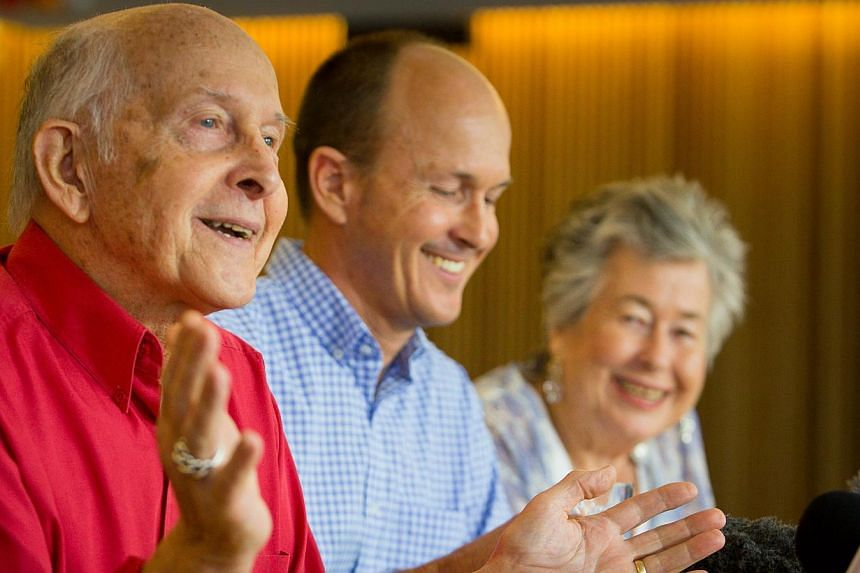 Juris Greste (left), the father of Australian journalist Peter Greste, smiles as Peter's brother Andrew Greste (centre) and his mother Lois Greste (right) look on, during a press conference in Brisbane on Feb 2, 2015 after Cairo deported Peter, the a