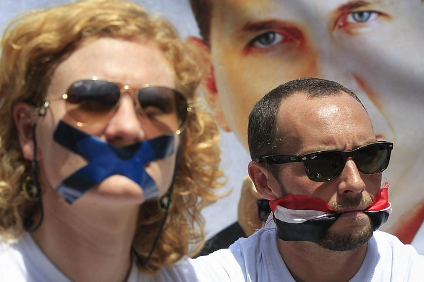 Nairobi-based foreign correspondents sitting in front of Egyptian embassy in Nairobi to protest against imprisonment of Al Jazeera journalists Peter Greste and his colleagues in Egypt in afile photograph dated Feb 4 last year.According to