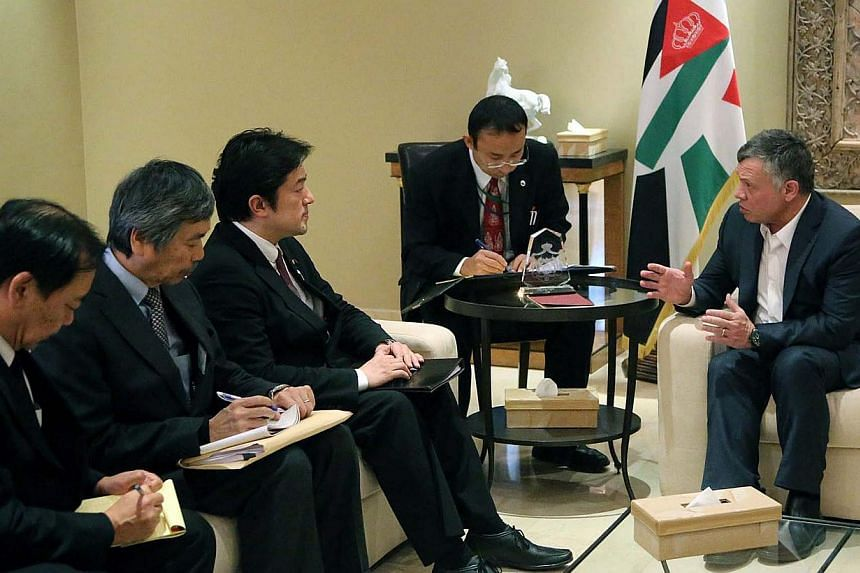Jordan King Abdullah II (right) meeting with Japanese State Minister for Foreign Affairs Yasuhine Nakayama (third from left) in Amman, Jordan on January 21 in a handout photo released by theJordanian Royal Palace.The meeting focussed on t