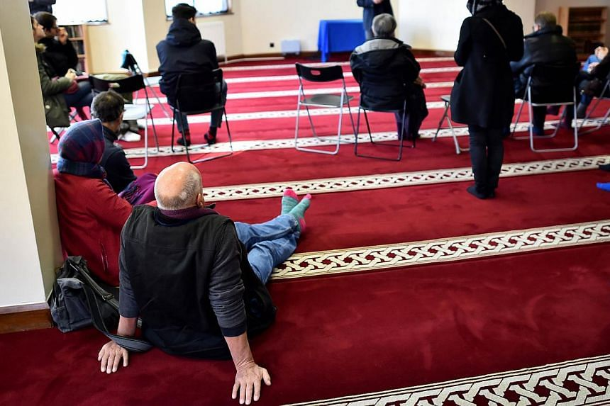 Visitors listen to a presentation during an open day at the Finsbury Park mosque in London on Sunday. Mosques around Britain opened their doors to the public on Sunday in an initiative led by the Muslim Council of Britain to reassure people concerned