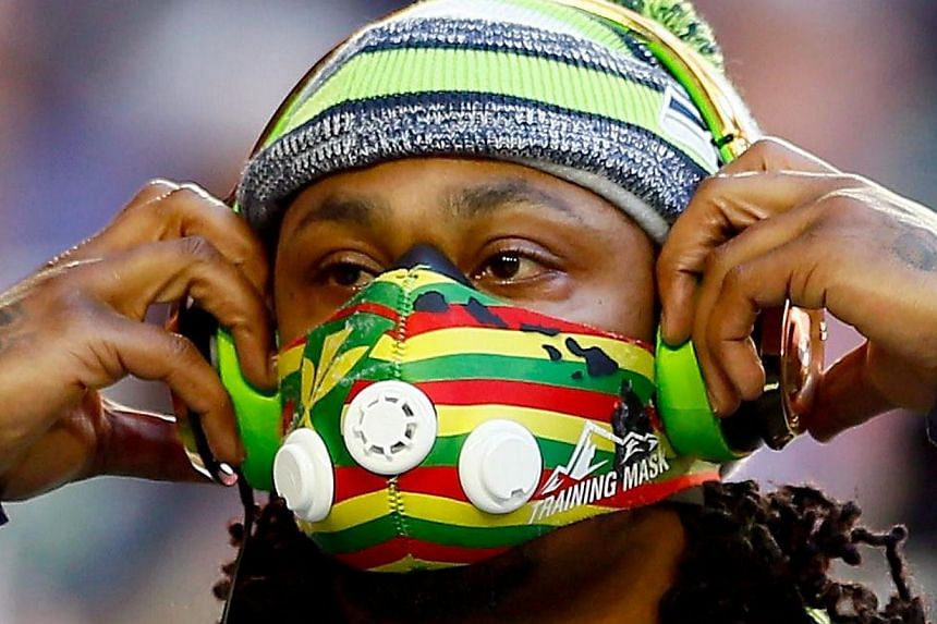 Marshawn Lynch of the Seattle Seahawks warms up prior to Super Bowl XLIX against the New England Patriots at University of Phoenix Stadium this morning in Glendale, Arizona. -- PHOTO: AFP