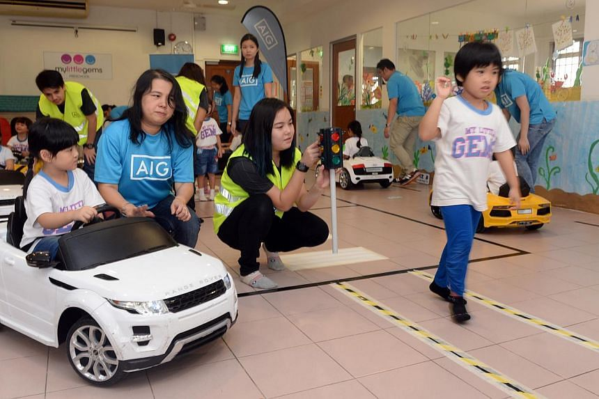 45 pre-school children at My Little Gems Kindergarten took on the roles of motorists and pedestrians in a road safety education programme on Monday. AIG is launching it to teach children between ages 4 to 6 to be safe on roads in Singapore. -- ST PHO