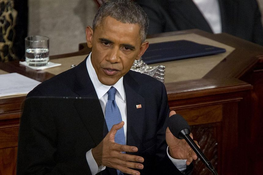 United States President Barack Obama's fiscal 2016 Budget proposes US$7.4 billion (S$10 billion) to fund clean energy technologies and a US$4 billion fund to encourage US states to make faster and deeper cuts to emissions from power plants. -- PHOTO: