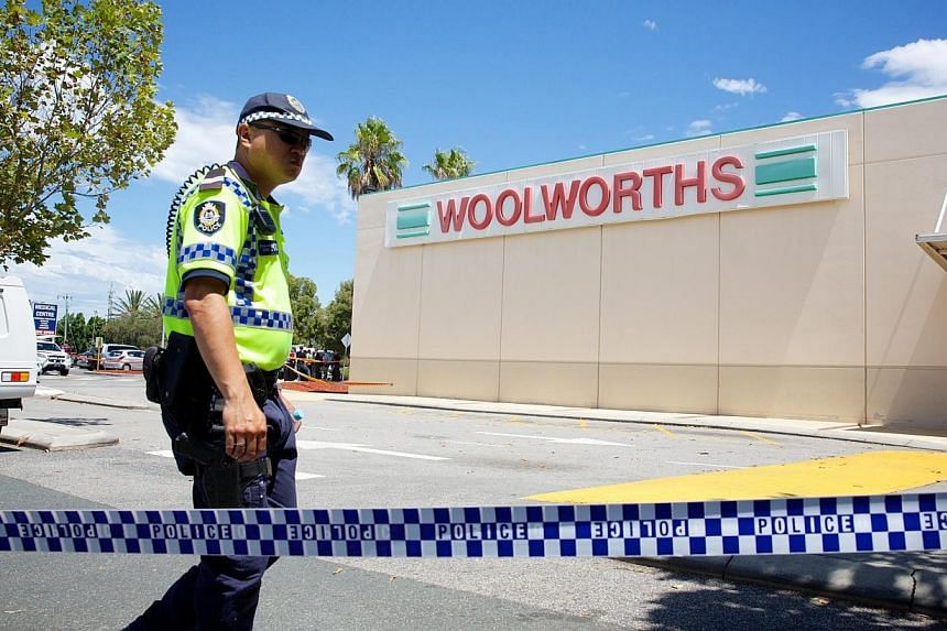 Police and firefighters at the scene of an explosion at the Galleria Shopping Centre in Morley, Perth, Australia, on Feb 03, 2015. An explosion in an electrical transformer room at a shopping centre in the west Australian city of Perth has left two m