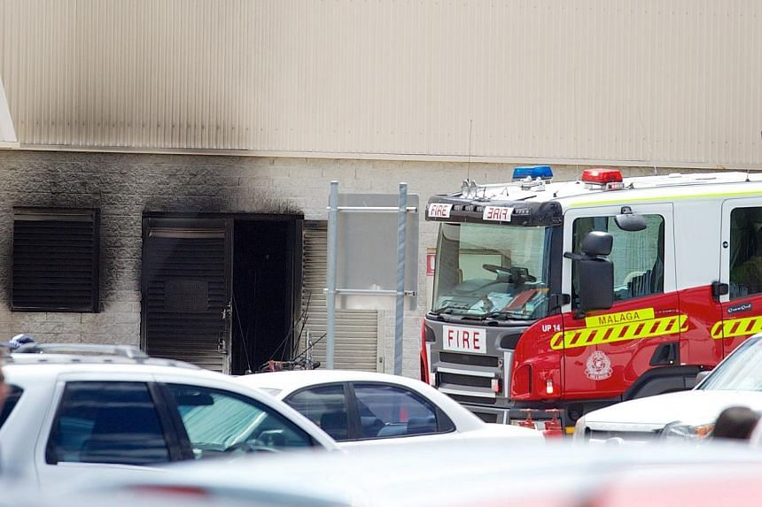 Police and firefighters at the scene of an explosion at the Galleria Shopping Centre in Morley, Perth, Australia, on Feb 03, 2015.An explosion in an electrical transformer room at a shopping centre in the west Australian city of Perth has left
