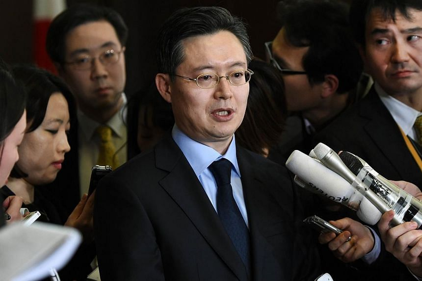 South Korean envoy for North Korean issues Hwang Joon Kook (centre) answers questions after a meeting with his US and Japanese conterparts in Tokyo on Jan 28, 2015. South Korea and China will resume talks this week on efforts to curb North Korea's nu
