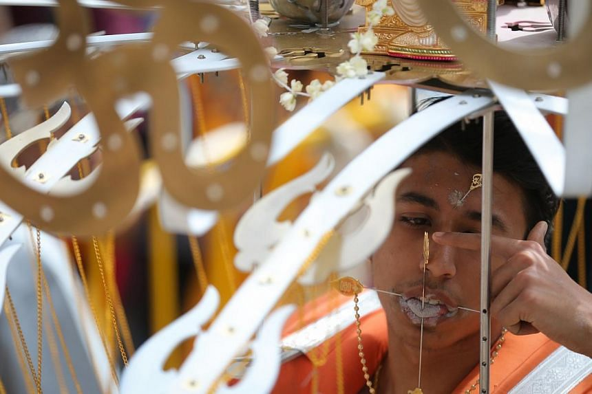 A devotee with a kavadi at Sri Thendayuthapani Temple during Thaipusam.-- ST PHOTO: ONG WEE JIN