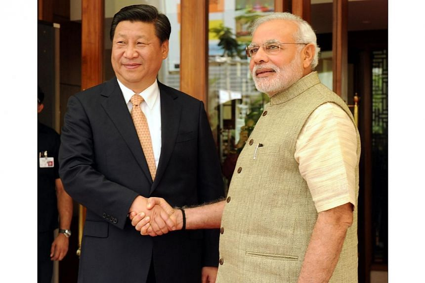 Indian Prime Minister Narendra Modi (right) welcoming Chinese President Xi Jinping at Hyatt Hotel, Ahmedabad, on Sept 17, 2014. -- PHOTO: PRESS INFORMATION BUREAU OF INDIA