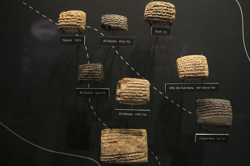 Cuneiform tablets are displayed during an exhibition at the Bible Lands Museum in Jerusalem on Feb 3, 2015. -- PHOTO: REUTERS