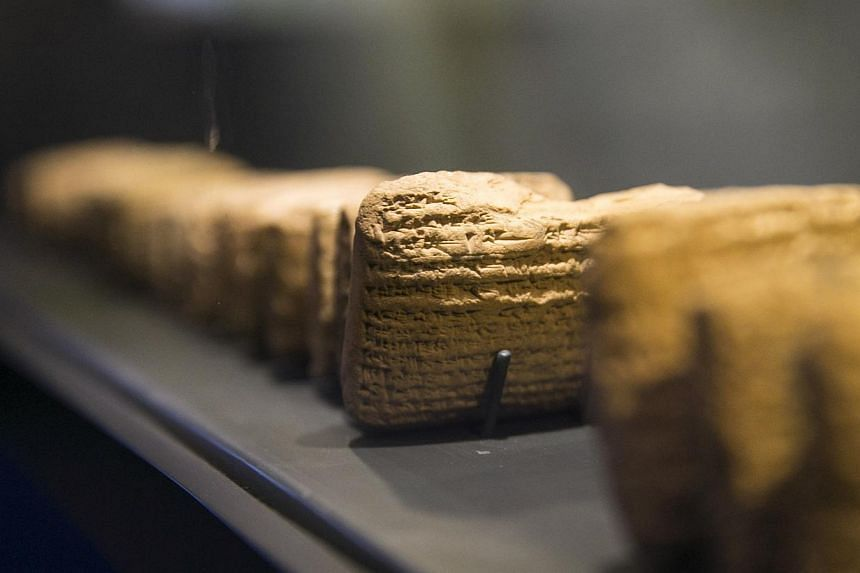 Cuneiform tablets are displayed during an exhibition at the Bible Lands Museum in Jerusalem on Feb 3, 2015. A new exhibition of ancient clay tablets discovered in modern-day Iraq is shedding light for the first time on the daily life of Jews exi
