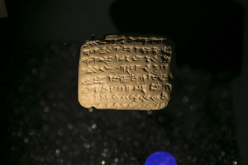 A cuneiform tablet is displayed during an exhibition at the Bible Lands Museum in Jerusalem on Feb 3, 2015. -- PHOTO: REUTERS