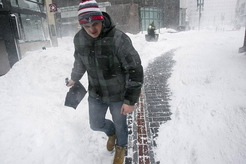 A man walking near the Freedom Trail during a snow storm in Boston, Massachusetts on Feb 2, 2015. -- PHOTO: REUTERS