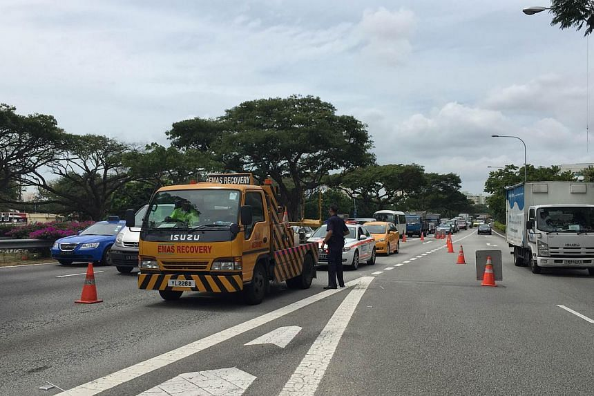 The incident caused a minor traffic snarl on the PIE. -- ST PHOTO:TIFFANY GOH