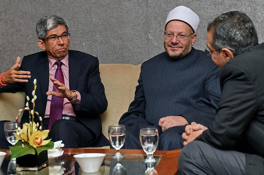 Dr Yaacob Ibrahim (left), Singapore's Minister-in-charge of Muslim Affairs, chatting with Egypt's Grand Mufti Sheikh Shawki Allam (centre) through a translator (right), prior Mr Allam's lecture in Singapore on Jan 26, 2015. Dr Yaacob will lead Singap