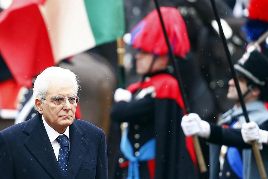 Italy's new President Sergio Mattarella inspects a guard of honour during a welcoming ceremony at the Quirinale presidential palace in Rome, Feb 3, 2015. President Tony Tan Keng Yam has sent a congratulatory letter to Mr Sergio Mattarella who was swo