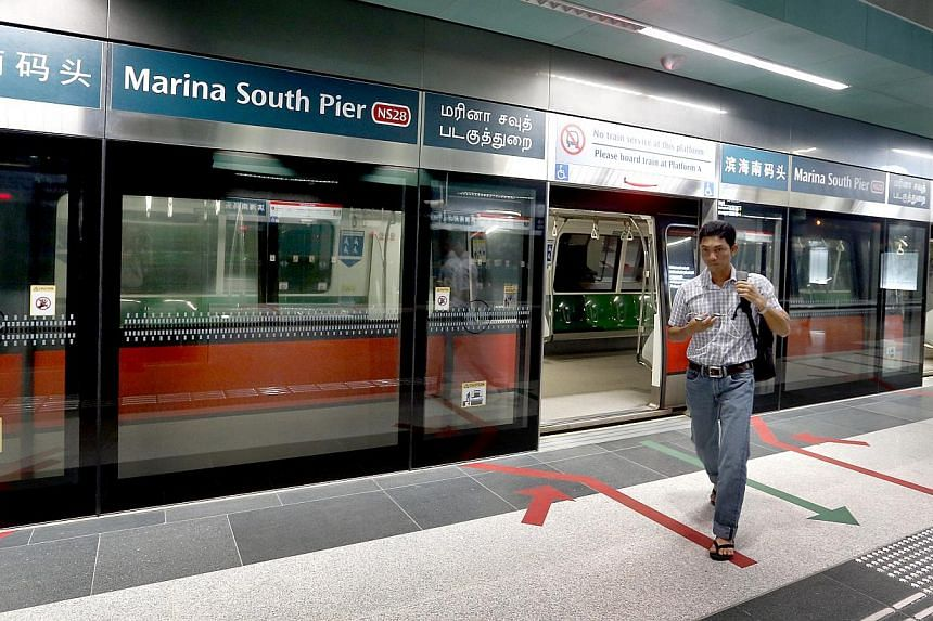 A passenger alighting at Marina South Pier MRT station on the morning of Feb 3, 2015. -- ST PHOTO: CHEW SENG KIM