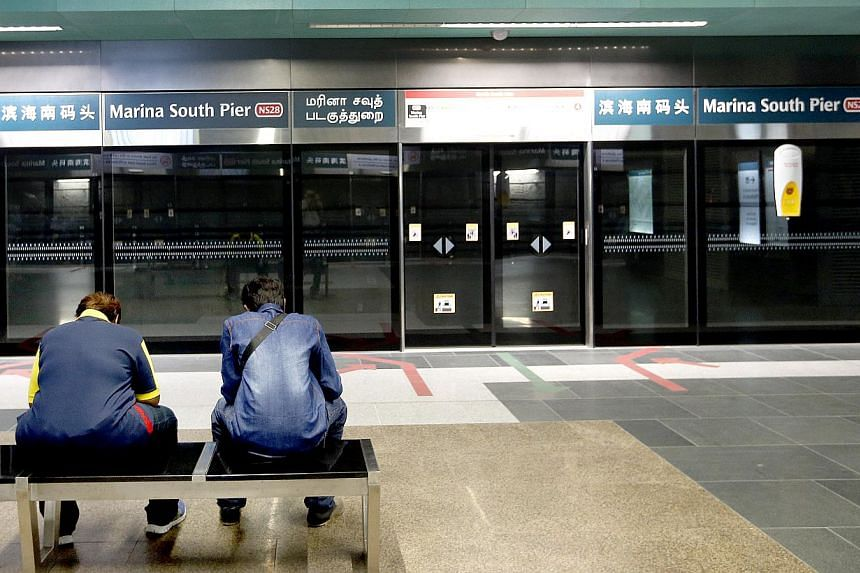 Passengers waiting to board the train at Marina South Pier MRT station on the morning of Feb 3, 2015. -- ST PHOTO: CHEW SENG KIM
