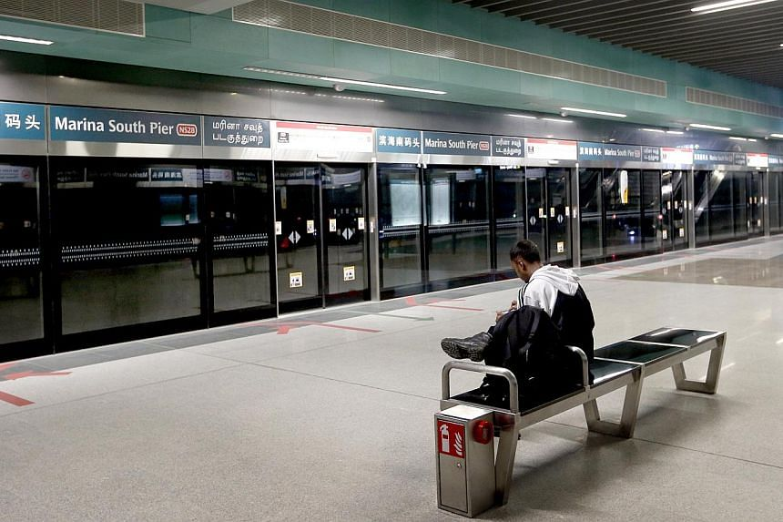 A passenger waiting to board the train at Marina South Pier MRT station on the morning of Feb 3, 2015. -- ST PHOTO: CHEW SENG KIM