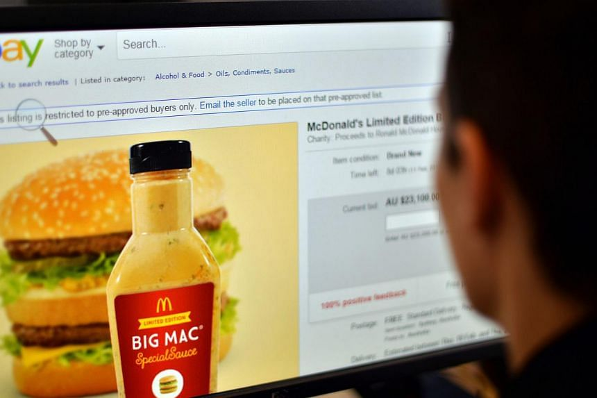 A woman in Sydney looking at a webpage of eBay offering bids for a bottle of fast-food giant McDonald's Big Mac special sauce. -- PHOTO: AFP